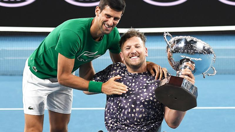 Dylan Alcott, pictured here posing with Novak Djokovic after winning the Australian Open.