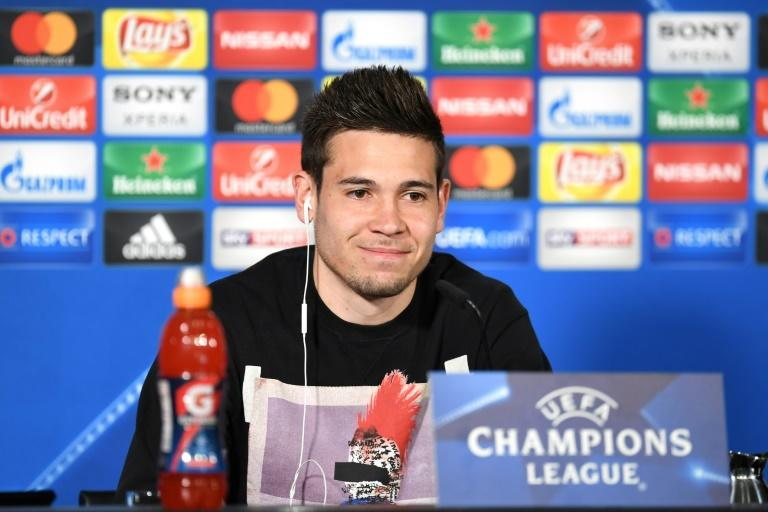 Dortmund's Portuguese defender Raphael Guerreiro answers questions during a press conference in Dortmund, on April 10, 2017