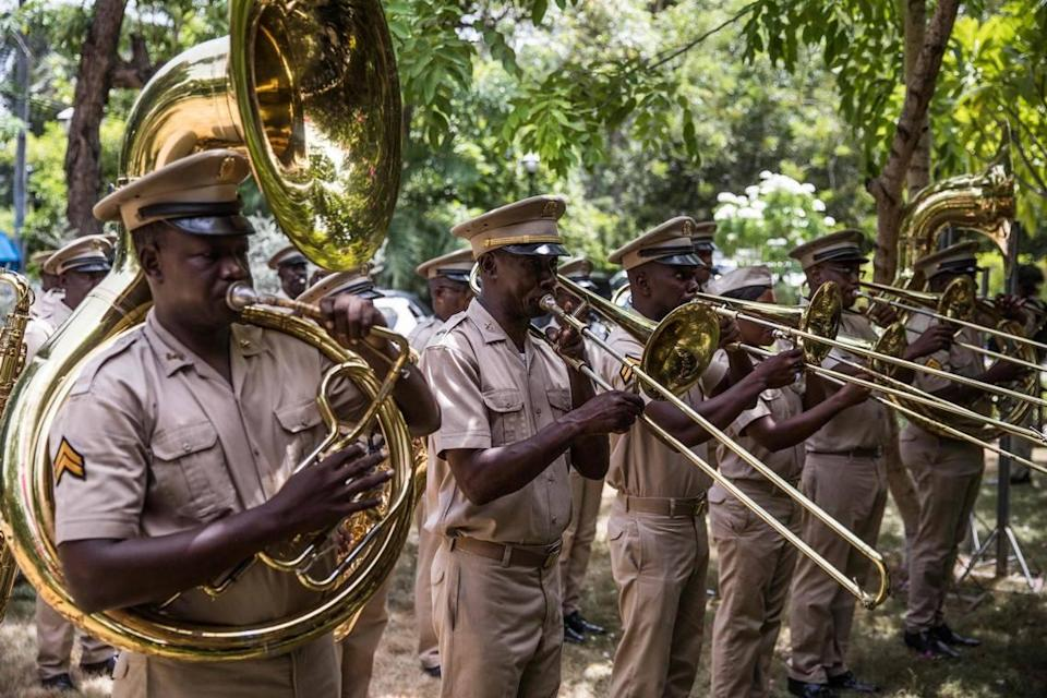 Members of the military band perform during a ceremony in honor of late Haitian President Jovenel Moïse in Port-au-Prince, Haiti, on July 20, 2021. The ceremony occurred as designated Prime Minister Ariel Henry prepared to replace interim Prime Minister Claude Joseph, after the July 7 attack at Moïse's private home.