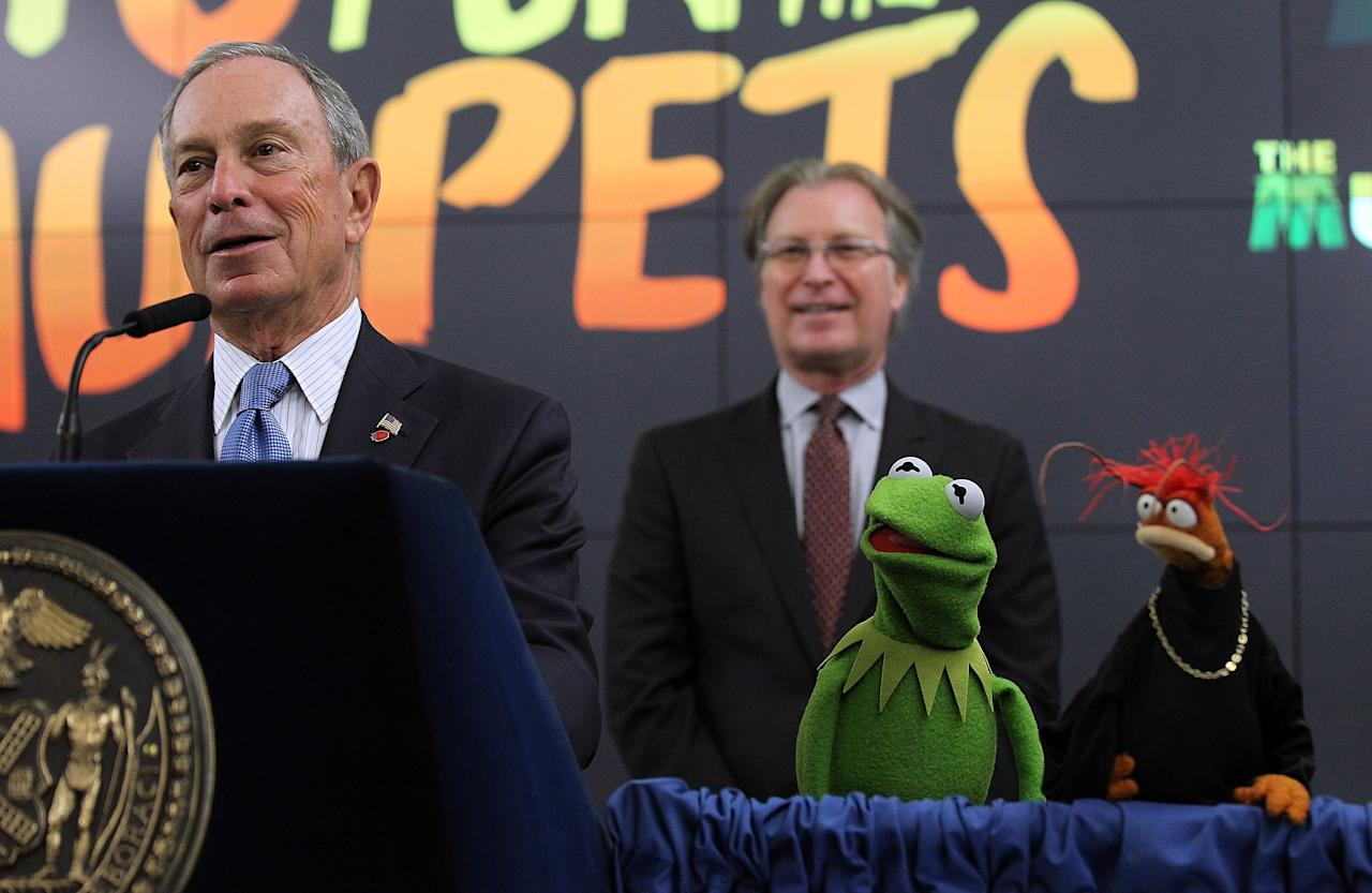 (L-R) New York City Mayor Michael Bloomberg speaks during a news conference with NYC and Co. CEO George Fertitta, the Muppets Kermit the Frog and Pepe the King Prawn on April 13, 2012 in New York City.  NYC Mayor Michael Bloomberg and NYC and Co. announced today that the Muppets will act as New York City's official family ambassadors for the next year. The Muppets will will encourage family travel to New York City by highlighting the best ways for families to experience the city.  (Photo by Justin Sullivan/Getty Images)