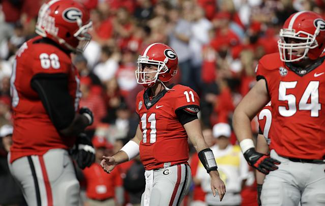 Georgia quarterback Aaron Murray walks off the field after throwing his second touchdown in the first half of an NCAA college football game against Appalachian State, Saturday, Nov. 9, 2013, in Athens, Ga. (AP Photo/David Goldman)