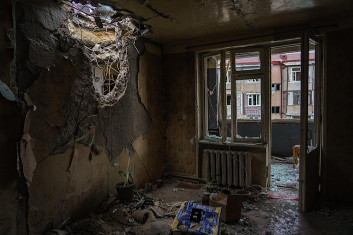 A view inside the living room where a weapon pierced through the ceiling of a residential building.
