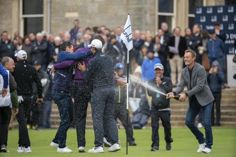 Victor Perez, centre left, is congratulated by his French Colleagues led by Raphael Jacquelin following his victory in the Links Championship at St Andrews in Scotland, Sunday Sept. 29, 2019. (Kenny Smith/PA via AP)