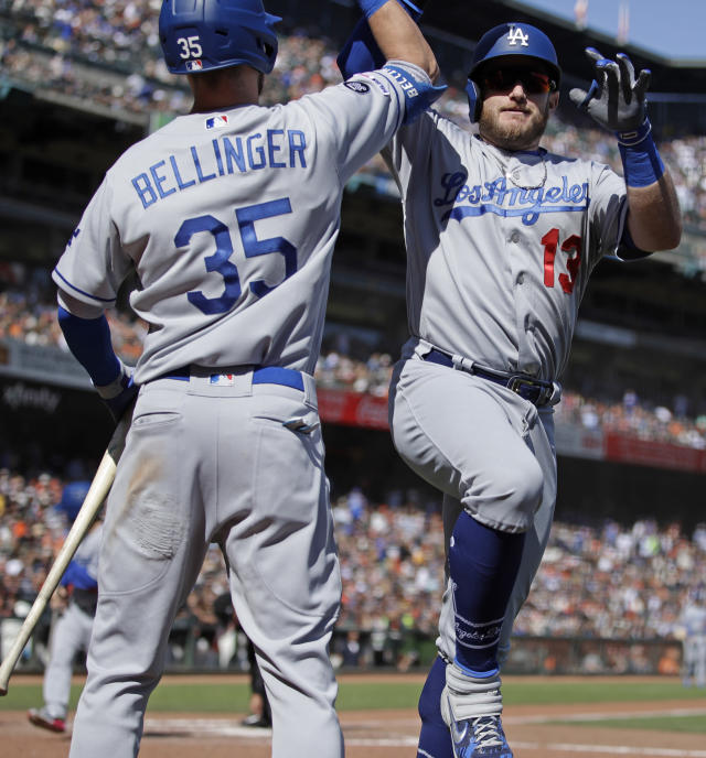 Los Angeles Dodgers' Max Muncy, right, celebrates with Cody Bellinger (35) after hitting a home run off San Francisco Giants' Logan Webb in the sixth inning of a baseball game Saturday, Sept 28, 2019, in San Francisco. (AP Photo/Ben Margot)