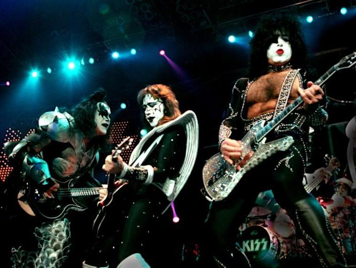Glenn Koenig –– – (left to right) Members of the rock band KISS, Gene Simmons,Ace Frehley, and Paul Stanley as the band performed at the Pond.