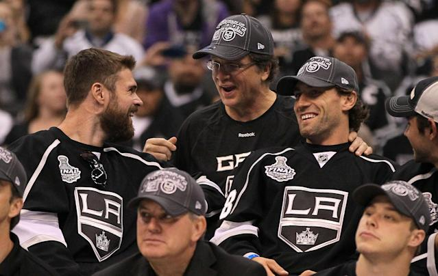 LOS ANGELES, CA - JUNE 14: (L-R) Willie Mitchell #33, General Manager Dean Lombardi and Jarret Stoll #28 of the Los Angeles Kings share a laugh as team President/CEO Tim Leiweke (bottom L) and captain Dustin Brown #23 (bottom R) look on during the rally in Staples Center after the Los Angeles Kings Stanley Cup Victory Parade on June 14, 2012 in Los Angeles, California. (Photo by Victor Decolongon/Getty Images)
