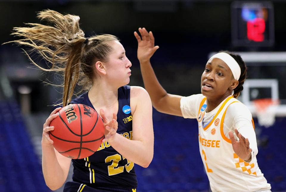 Michigan's Danielle Rauch (23) looks to pass ahead of Tennessee's Destiny Salary (2) during their second-round game.