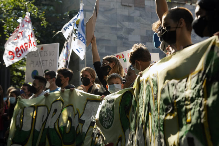 Students march as part of the Fridays for Future climate movement's initiatives, in Milan, Italy, Friday, Sept. 24, 2021. (AP Photo/Luca Bruno)