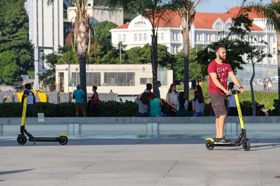Brazilian cities adopt legislation contrary to the use of electric scooters after the increase of accidents and abuses of users of the system. In the cities of Rio and São Paulo, users drop off electric scooters anywhere, disrupting the passage of pedestrians and people with disabilities and also causing accidents. With this, the main Brazilian cities have started to create rules of use that require the use of helmets and even that the users do a test of habilitation to be able to direct the electric vehicles. In this image: Child uses Yellow's electric scooter to get around the Museum of Tomorrow in Downtown Rio. (Photo by Luiz Souza/NurPhoto via Getty Images)