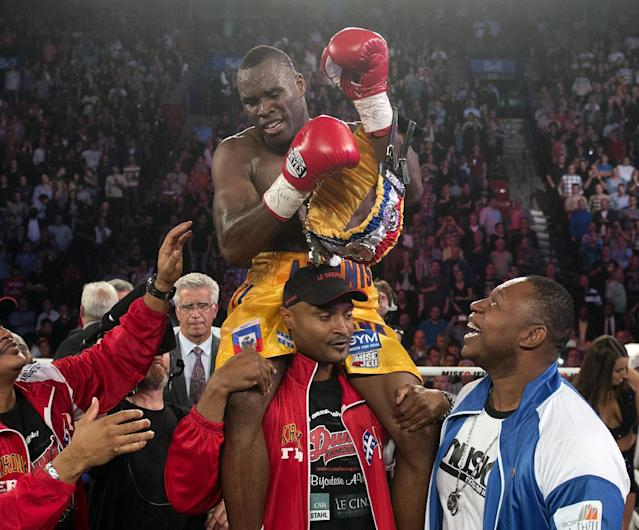 Adonis Stevenson, from Montreal, celebrates after defeating Tavoris Cloud to defend his light heavyweight title in a boxing bout Saturday, Sept. 28, 2013, in Montreal. (AP Photo/The Canadian Press, Ryan Remiorz)