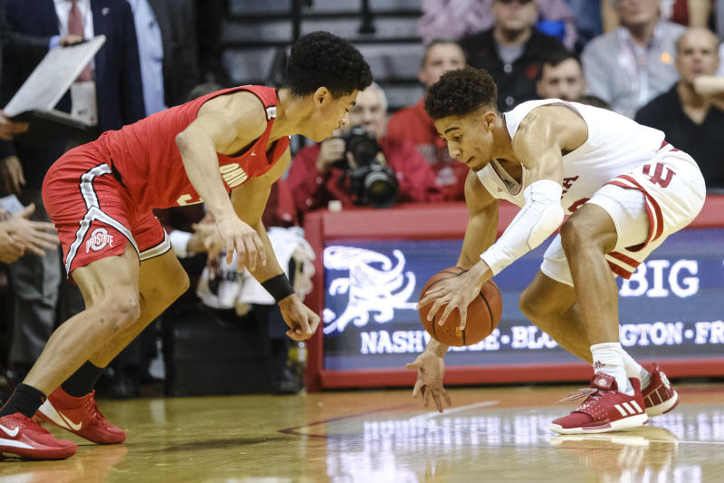Indiana guard Rob Phinisee, right, steals the ball from Ohio State guard D.J. Carton during the first half of an NCAA college basketball game in Bloomington, Ind., Saturday, Jan. 11, 2020. (AP Photo/AJ Mast)