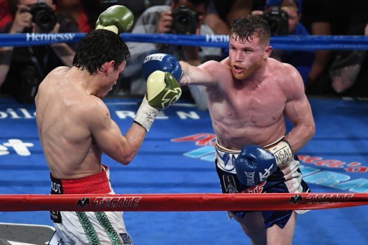 Canelo Alvarez (R) reaffirmed his position as boxing's biggest draw by selling nearly 1 million pay-per-views for his bout with Julio Cesar Chavez Jr. (Getty Images)