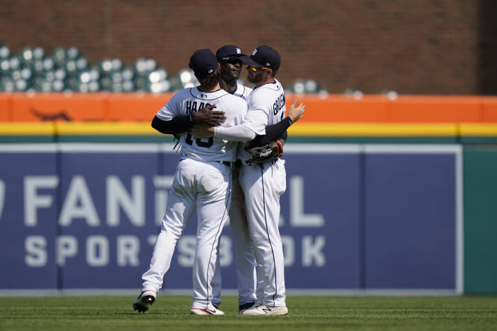 From left, Detroit Tigers left fielder Eric Haase (13), center fielder Daz Cameron (41) and right fielder Robbie Grossman (8) celebrate the Tigers' 8-3 win over the Seattle Mariners in a baseball game, Thursday, June 10, 2021, in Detroit. (AP Photo/Carlos Osorio)