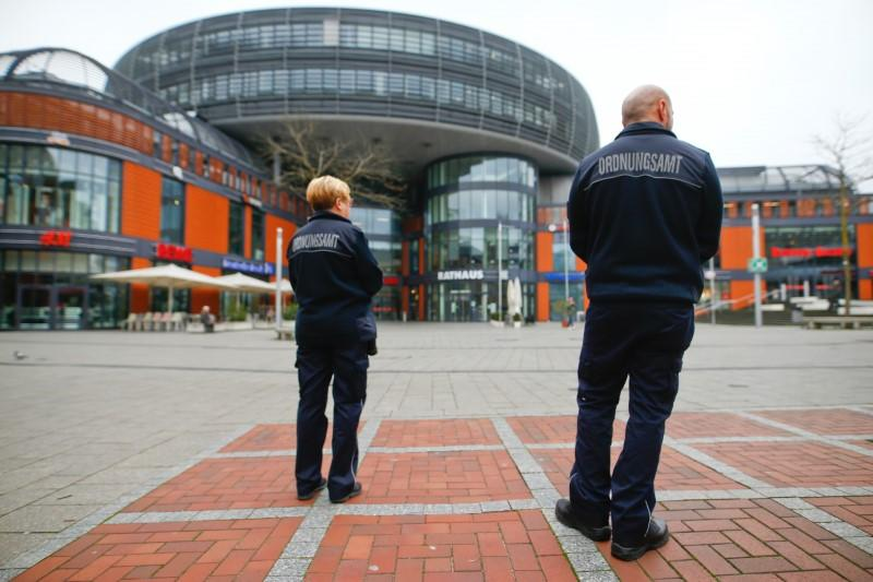 Employees of the Public order office patrol during a partial lockdown in Leverkusen