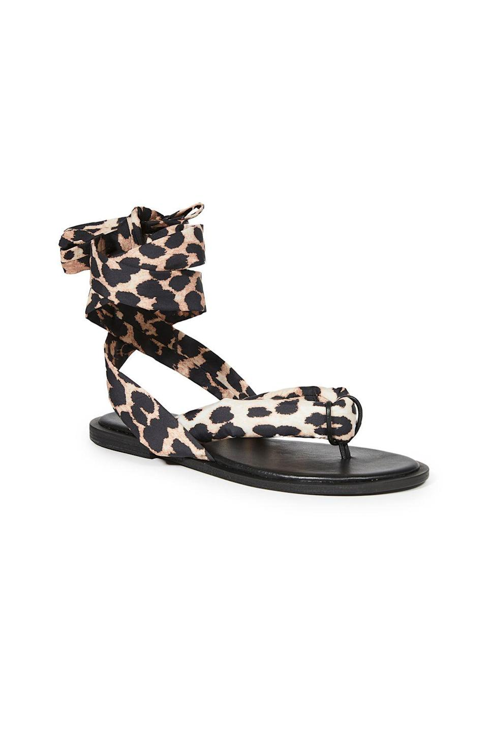 """<p><strong>Ganni</strong></p><p>shopbop.com</p><p><strong>$155.00</strong></p><p><a href=""""https://go.redirectingat.com?id=74968X1596630&url=https%3A%2F%2Fwww.shopbop.com%2Fpuffy-wrap-sandals-ganni%2Fvp%2Fv%3D1%2F1507389545.htm&sref=https%3A%2F%2Fwww.marieclaire.com%2Ffashion%2Fg34126792%2Fspring-shoe-trends-2021%2F"""" rel=""""nofollow noopener"""" target=""""_blank"""" data-ylk=""""slk:Shop Now"""" class=""""link rapid-noclick-resp"""">Shop Now</a></p><p>Animal print? Check. Extra volume? Check. Ankle wrap detail? Check. Ideal summer sandal? Big check.</p>"""