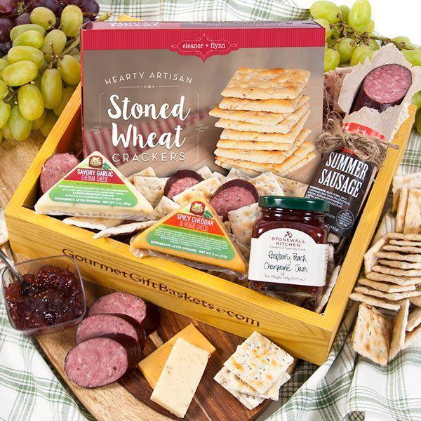 """<p><strong>Gourmet Gift Baskets</strong></p><p>gourmetgiftbaskets.com</p><p><strong>$39.99</strong></p><p><a href=""""https://go.redirectingat.com?id=74968X1596630&url=https%3A%2F%2Fwww.gourmetgiftbaskets.com%2FGourmet-Meat-And-Cheese-Sampler.asp&sref=https%3A%2F%2Fwww.goodhousekeeping.com%2Fholidays%2Fmothers-day%2Fg19694294%2Fmothers-day-gift-basket-ideas%2F"""" rel=""""nofollow noopener"""" target=""""_blank"""" data-ylk=""""slk:Shop Now"""" class=""""link rapid-noclick-resp"""">Shop Now</a></p><p>Just like the name implies, this sampler is stocked with cheese, crackers, spreads, and summer sausage to round out her cheeseboard. Plus, you can personalize your gift by adding a custom photo greeting card. </p>"""
