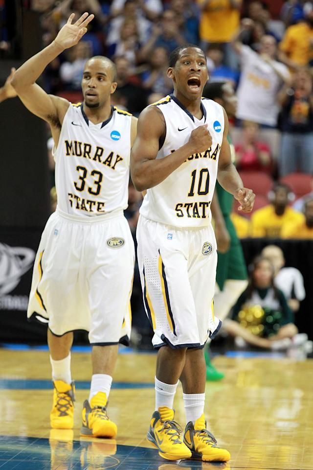 LOUISVILLE, KY - MARCH 15:  Jewuan Long #33 and Zay Jackson #10 of the Murray State Racers reacts after a play against the Colorado State Rams during the second round of the 2012 NCAA Men's Basketball Tournament at KFC YUM! Center on March 15, 2012 in Louisville, Kentucky.  (Photo by Andy Lyons/Getty Images)