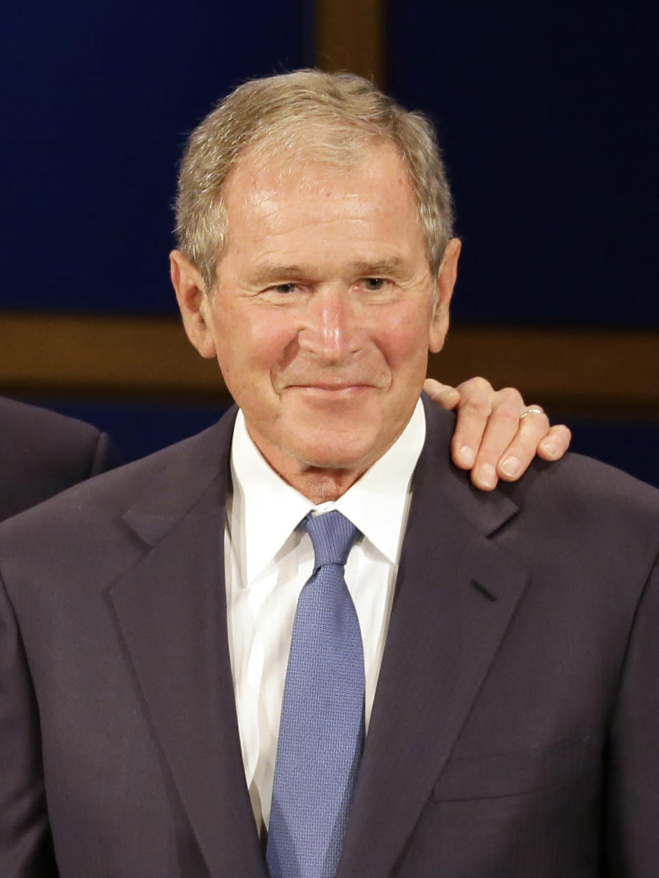 "FILE - Former President George W. Bush, appears during a discussion at the Presidential Leadership Scholars graduation ceremony at the George W. Bush Presidential Center in Dallas on July 13, 2017. Bush will honor American immigrants in a book coming out in March. Bush's ""Out Of Many, One: Portraits of America's Immigrants"" includes 43 portraits by the 43rd president. (AP Photo/Tony Gutierrez, File)"