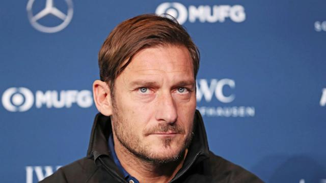 Francesco Totti followed in the footsteps of Olympic great Michael Phelps by picking up the Laureus Exceptional Achievement award.