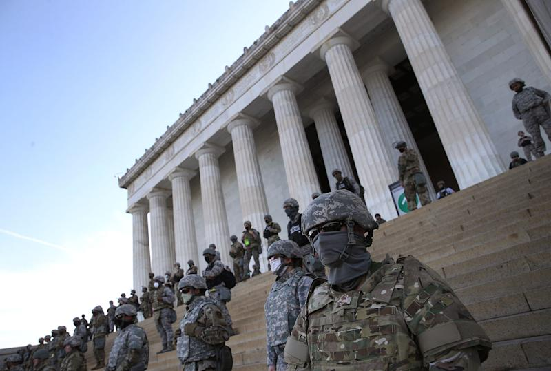 Members of the D.C. National Guard stand on the steps of the Lincoln Memorial as demonstrators participate in a peaceful protest against police brutality and the death of George Floyd. (Photo: Win McNamee via Getty Images)