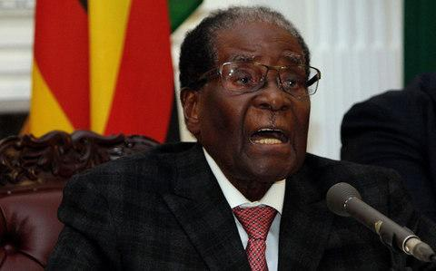 Zimbabwean President Robert Mugabe delivers his speech during a live broadcast at State House in Harare, Sunday, Nov, 19 - Credit: AP