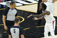 Los Angeles Clippers guard Patrick Beverley, right, shows officials blood on his hand as he reacts after being called for a foul on Phoenix Suns guard Devin Booker during the second half of Game 2 of the NBA basketball Western Conference Finals, Tuesday, June 22, 2021, in Phoenix. (AP Photo/Matt York)