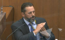 In this image from video, Minneapolis Police Lt. Johnny Mercil, a use of force trainer, testifies as Hennepin County Judge Peter Cahill presides Tuesday, April 6, 2021, in the trial of former Minneapolis police Officer Derek Chauvin at the Hennepin County Courthouse in Minneapolis. Chauvin is charged in the May 25, 2020 death of George Floyd. (Court TV via AP, Pool)