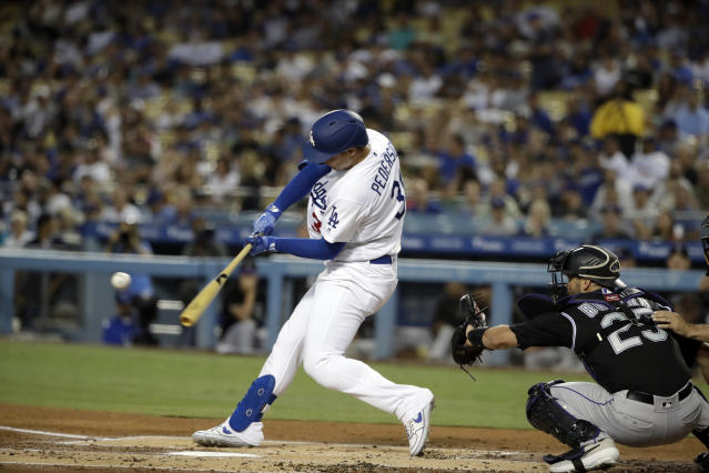 Los Angeles Dodgers' Joc Pederson hits a solo home run against the Colorado Rockies during the first inning of a baseball game Wednesday, Sept. 4, 2019, in Los Angeles. (AP Photo/Marcio Jose Sanchez)