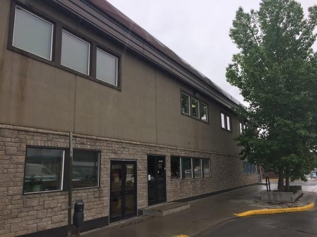 Police say they used an 'extended range impact weapon' to subdue a woman armed with a hatchet who was trying to break into the Multicultural Centre of the Yukon in downtown Whitehorse on June 4. (Steve Silva/CBC - image credit)