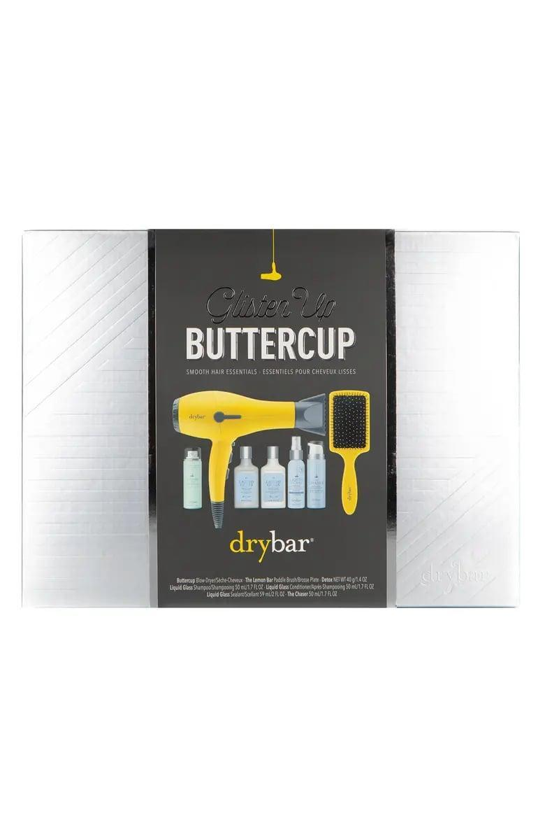 <p>The <span>Drybar Glisten Up Buttercup Smooth Hair Essentials Set</span> ($199) includes styling products, a paddle brush, and the coveted Buttercup blow-dryer. </p>