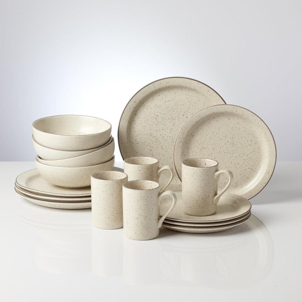 <p>I initially wanted a colorful set of speckled dishware, but I'm glad we landed on this neutral shade. It ties together nicely with our green glassware, and the <span>Kallan 16pc Dinnerware Set</span> ($100) packs a lot of value.</p>