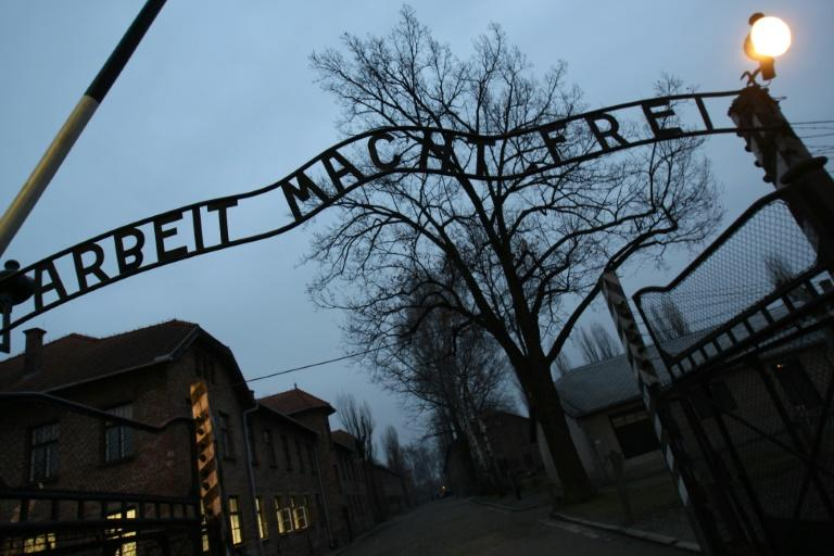 Merkel will walk through the infamous gate of the Auschwitz death camp