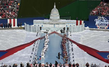 The teams line up for the national anthem in front of a model of the U.S. Capitol. (AP)
