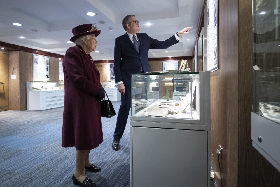 LONDON, UNITED KINGDOM - FEBRUARY 25: Queen Elizabeth II looks at artifacts relating to MI5 D-Day operations with Director General Andrew Parker during a visit to the headquarters of MI5 at Thames House on February 25, 2020 in London, England. MI5 is the United Kingdom's domestic counter-intelligence and security agency. (Photo by Victoria Jones - WPA Pool/Getty Images)