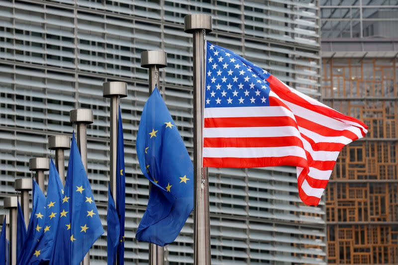 FILE PHOTO: FILE PHOTO: U.S. and EU flags are pictured during a visit by U.S. Vice President Pence to the European Commission headquarters in Brussels