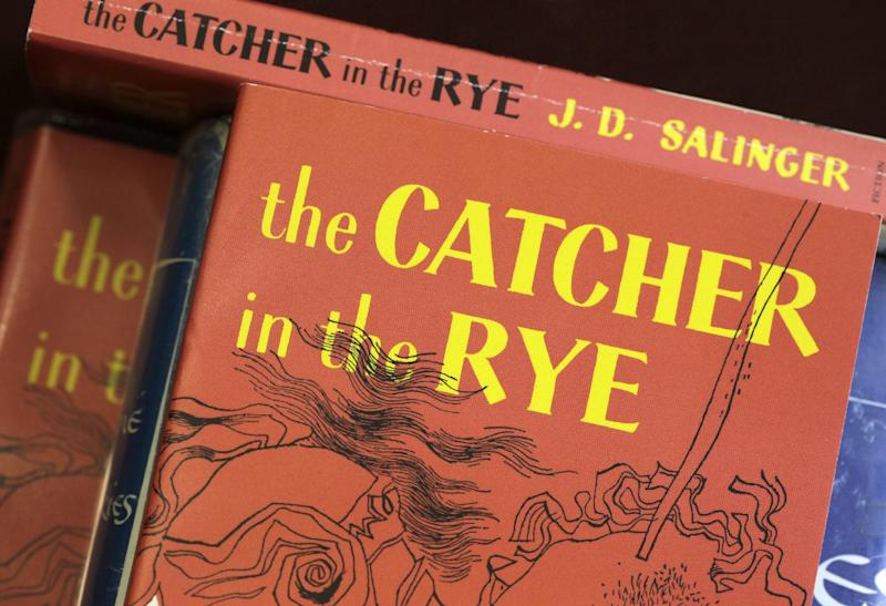 """FILE - This Jan. 28, 2010, file photo, shows copies of J.D. Salinger's classic novel """"The Catcher in the Rye"""" at the Orange Public Library in Orange Village, Ohio. Screenwriter Shane Salerno has taken on a surprising and news-making identity: the latest, and, apparently, greatest seeker of clues about J.D. Salinger. Salerno is presenting his case in """"Salinger,"""" a unique, 3-way project: A 700-page book, co-authored with David Shields; a theatrical release distributed by the Weinstein Company; and a TV documentary that will air on PBS in January 2014 as the 200th installment of """"American Masters."""" (AP Photo/Amy Sancetta, File)"""