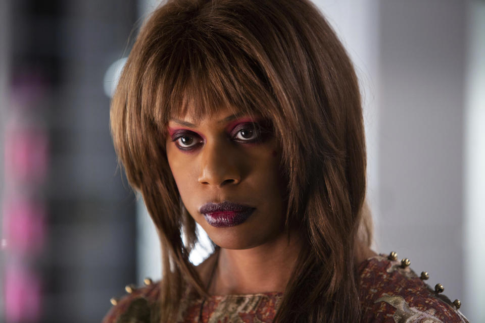 """This image released by Hulu shows Laverne Cox in a scene from """"Bad Hair,"""" a comedy-horror about woman trying to rise in the late-80s music business who gets a demonic weave. The film premieres Friday on Hulu. (Tobin Yellan/Hulu via AP)"""