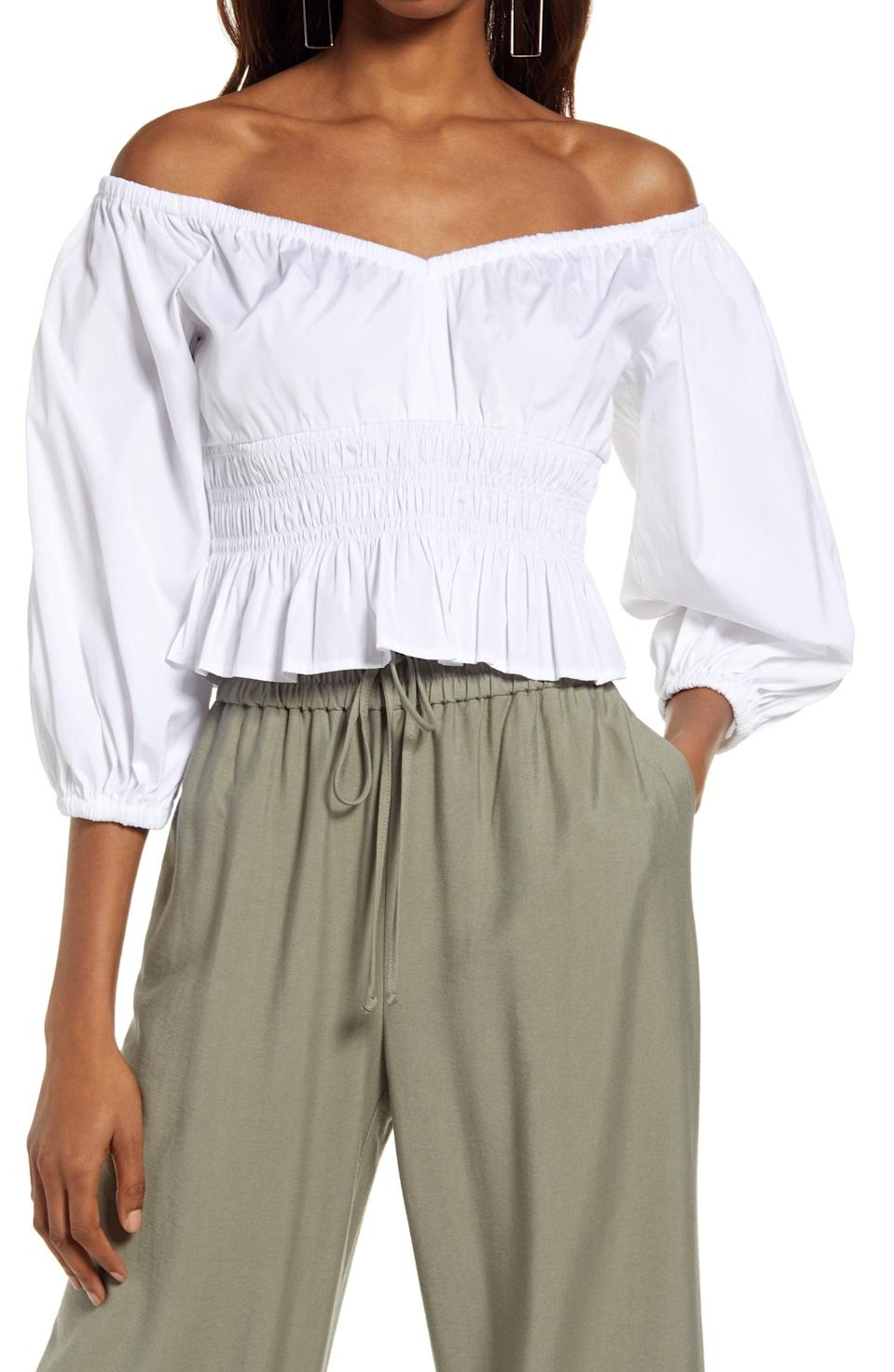 <p>This <span>Open Edit Off the Shoulder Cotton Poplin Blouse</span> ($55) features a ruched bodice and long sleeves that make it preppy and cute.</p>