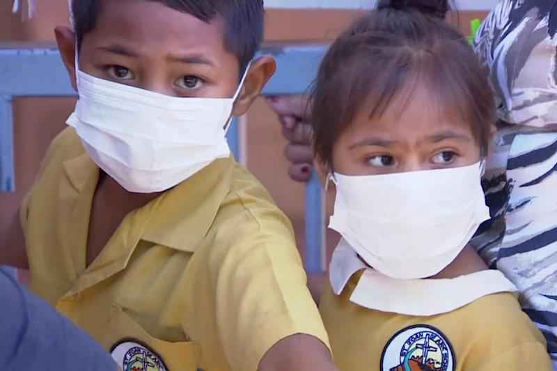 Masked children wait to be vaccinated at a health clinic in Apia, Samoa: AP