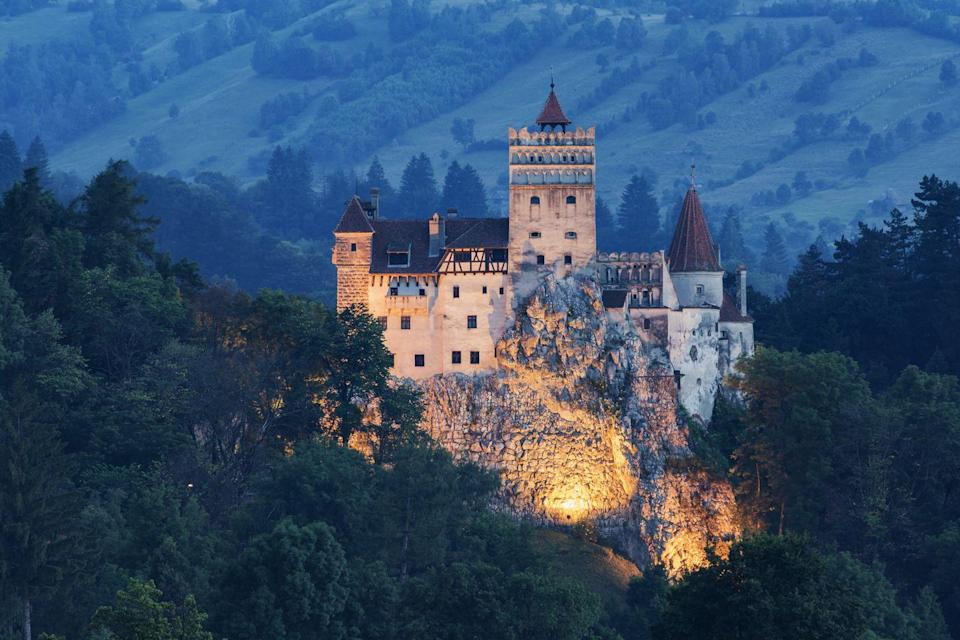 """<p>You might recognize this 13th-century castle under its alternate name: <a href=""""http://www.bran-castle.com/"""" rel=""""nofollow noopener"""" target=""""_blank"""" data-ylk=""""slk:Dracula's Castle"""" class=""""link rapid-noclick-resp"""">Dracula's Castle</a>. SpooOOooky. Brave and adventurous souls are welcomed to tour the iconic grounds that sparked the legend...just be sure to wear a scarf or something that covers the neck. Maybe bring some garlic.</p>"""