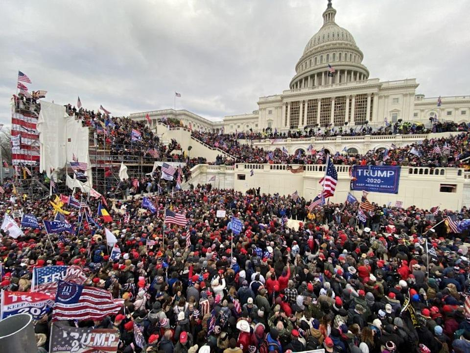 Violent rioters gather outside the Capitol building in Washington DC