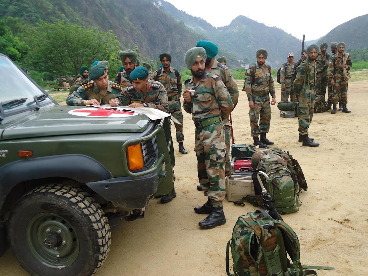 A team of army personal preparing for rescue of the people stranded at disaster affected areas on June 18, 2013 in Rudraprayag, India. Hundreds of people and tourists were stranded at various places after landslides triggered by incessant rains in Uttrakhand. (Photo by Badri Nautiyal/Hindustan Times via Getty Images)