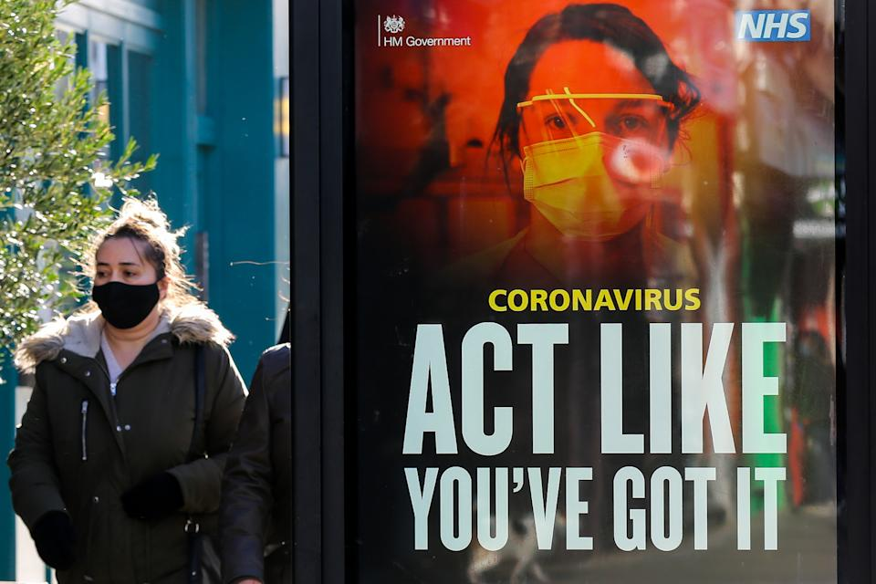 A woman walks past the 'Act Like You've Got It' coronavirus campaign advert in London. (Photo by Dinendra Haria / SOPA Images/Sipa USA)