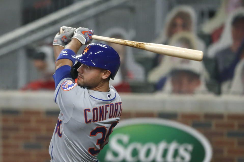 New York Mets' Michael Conforto (30) follows through on a ground rule double in the seventh inning of a baseball game against the Atlanta Braves Monday, Aug. 3, 2020, in Atlanta. (AP Photo/John Bazemore)