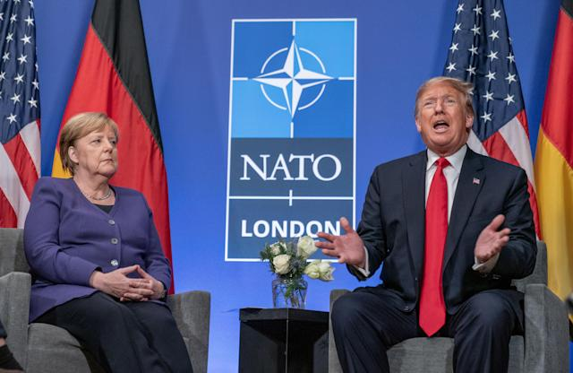 A stoic German chancellor Angela Merkel is seemingly unimpressed with US president Donald Trump at the NATO summit in London in December 2019. Photo: Michael Kappeler/Picture Alliance via Getty