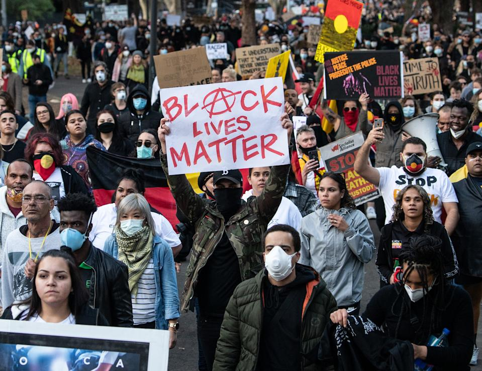 Protesters participate in a Black Lives Matter rally in Sydney, Saturday, June 6, 2020, against the deaths of Aboriginal people in custody.