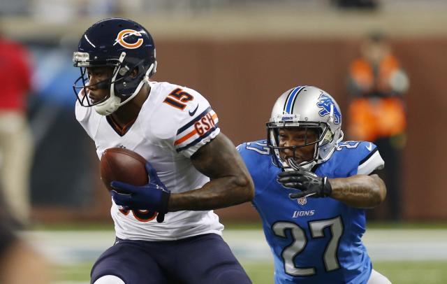 Chicago Bears wide receiver Brandon Marshall (15) pulls away from Detroit Lions strong safety Glover Quin (27) during the first quarter of an NFL football game at Ford Field in Detroit, Sunday, Sept. 29, 2013. (AP Photo/Paul Sancya)