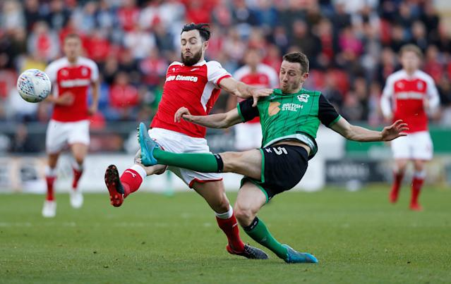 "Soccer Football - League One Play Off Semi Final Second Leg - Rotherham United vs Scunthorpe United - AESSEAL New York Stadium, Rotherham, Britain - May 16, 2018 Rotherham United's Richie Towell in action with Scunthorpe United's Murray Wallace Action Images/Ed Sykes EDITORIAL USE ONLY. No use with unauthorized audio, video, data, fixture lists, club/league logos or ""live"" services. Online in-match use limited to 75 images, no video emulation. No use in betting, games or single club/league/player publications. Please contact your account representative for further details."