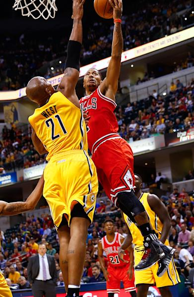 INDIANAPOLIS, IN - OCTOBER 05: Derrick Rose #1 of the Chicago Bulls shoots the ball against David West #21 of the Indiana Pacers during action on October 5, 2013 at Bankers Life Fieldhouse in Indianapolis, Indiana. (Photo by Michael Hickey/Getty Images)