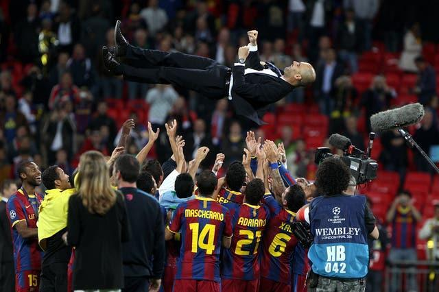 Barcelona coach Pep Guardiola is thrown into the air by his players after victory in the 2011 Champions League final